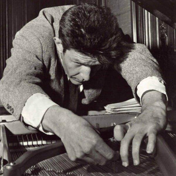 """John Cage, preparing a piano"", before 1950"